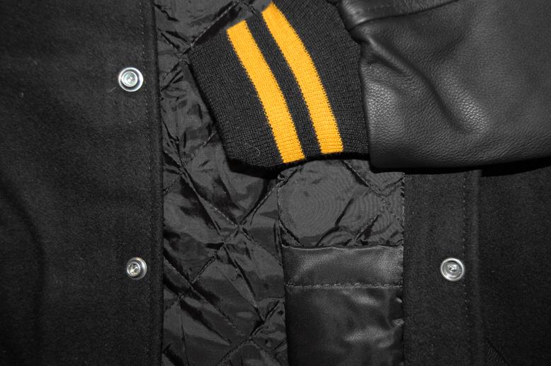 %20Varsity-Letterman-Jackets/black-black-gold-closeup-lining.jpg